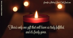 Image of candle and background lights with text: there's only one gift that will leave us fulfilled