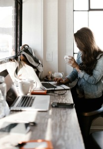 Woman sitting at cluttered desk