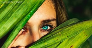 Image of women hiding behind a plant