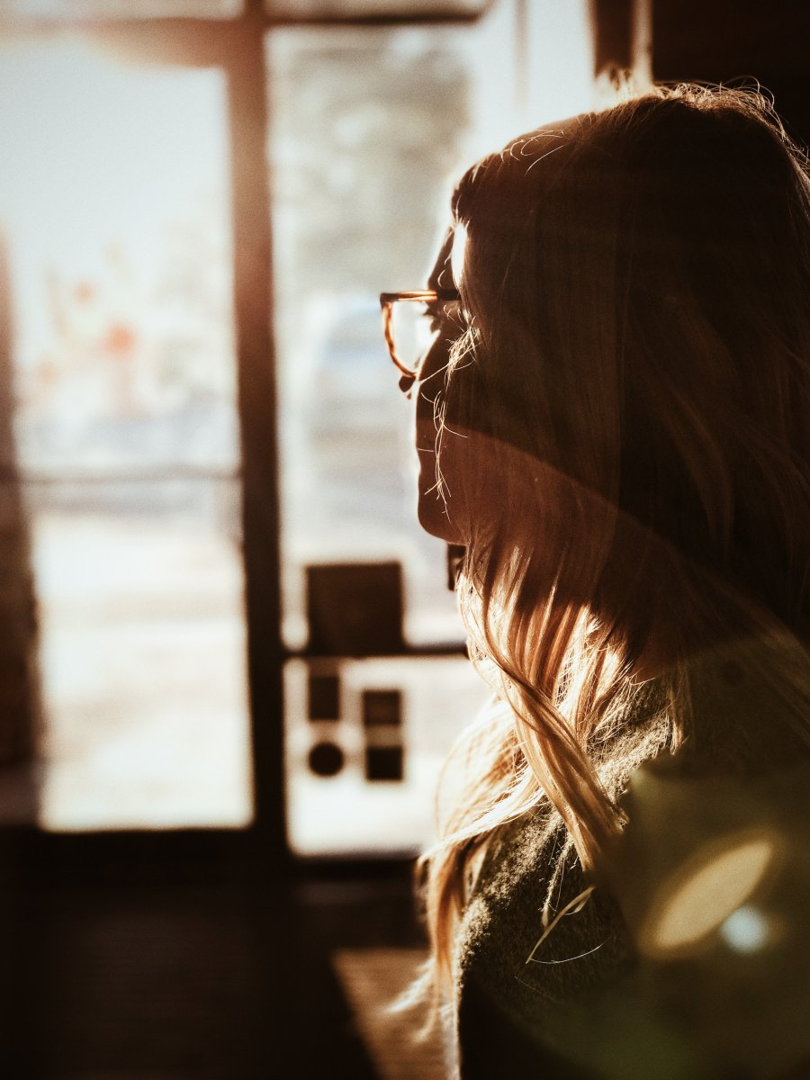 Image of woman staring out the window