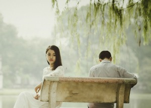 couple sitting with backs turned to each other