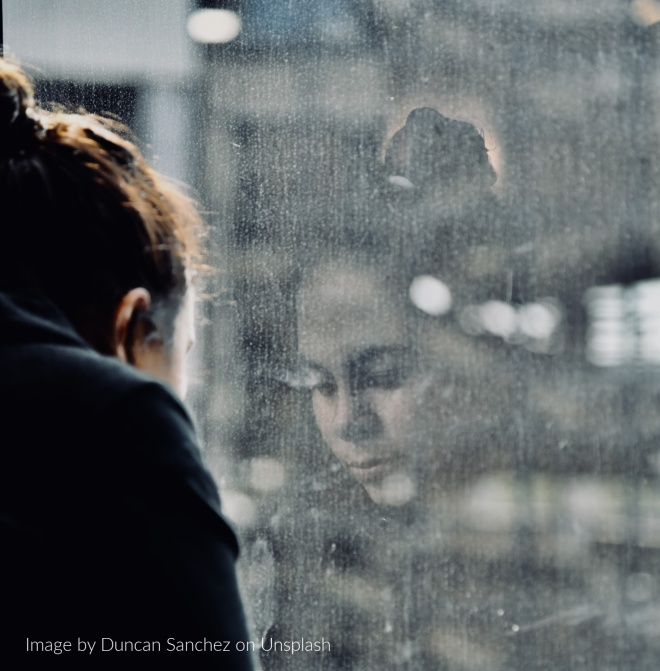 Woman staring out a window.