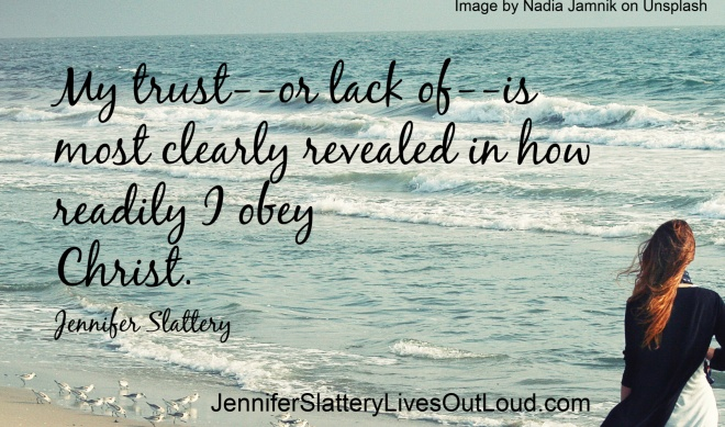 woman walking along beach with quote pulled from post