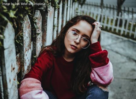 Sad woman sitting on the ground