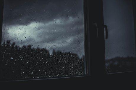 rain seen through the window on a dark, stormy night