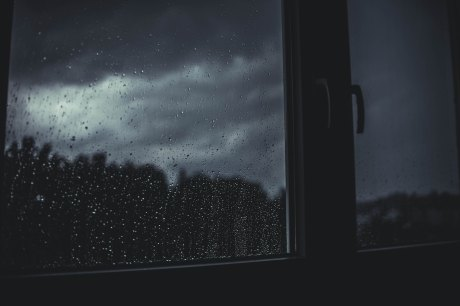 rain seen through the window on a dark, stormy night