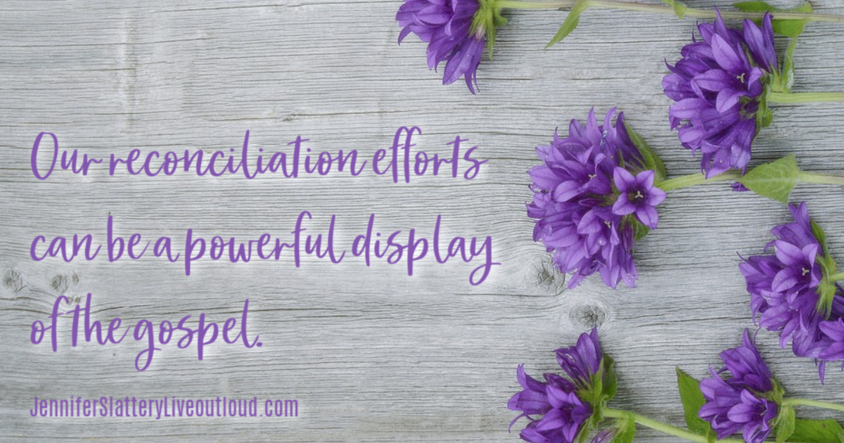 purple flowers against a wooden fence with words pulled from post.