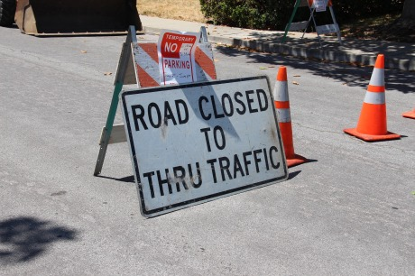 Road closed sign and cones