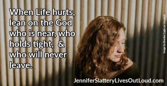 quote on leaning on God in hard times and image of a girl.