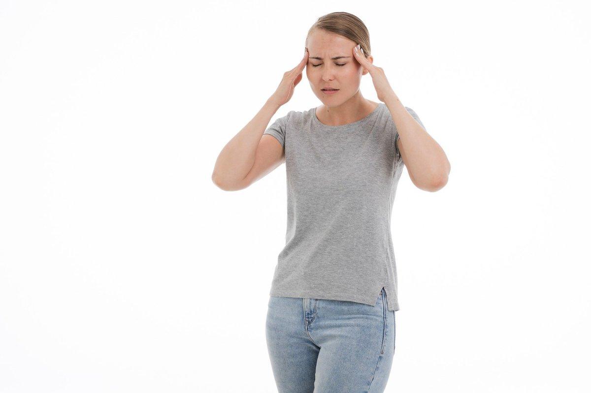 Woman experiencing a headache