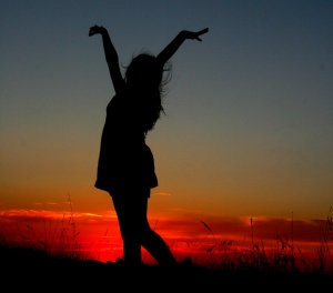 woman dancing in the sunset