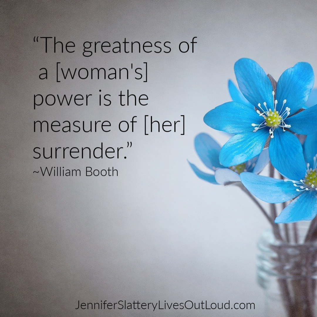 quote on surrender with flower in background