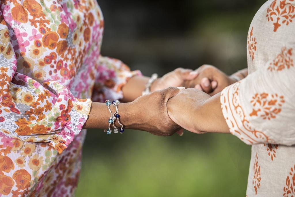 Two women praying together.