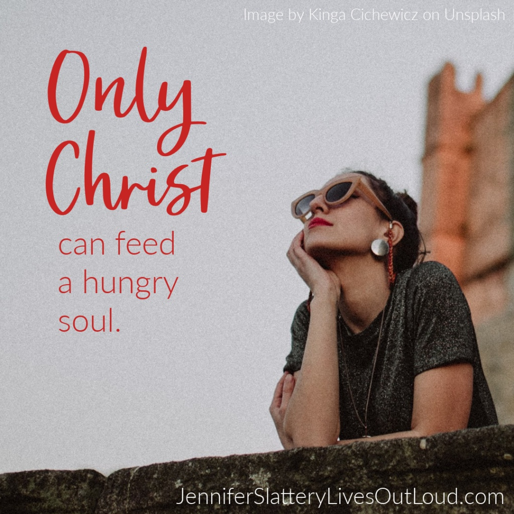 Quote on Christ feeding a hungry soul on an image of a woman gazing upward.