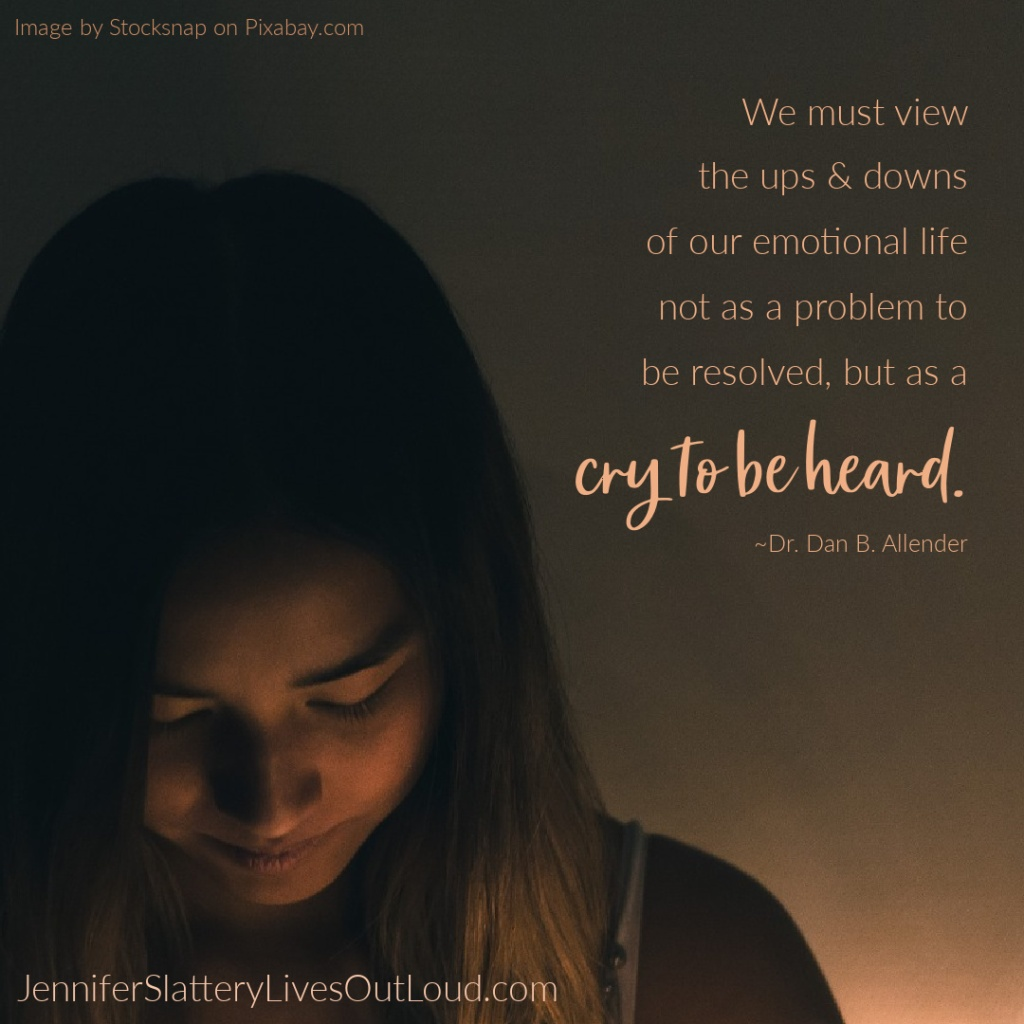 Woman at nightfall with quote on emotions crying to be heard.